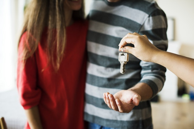 Couple receiving a key;Oriental-style bathroom; housekeeping services in Paducah KY