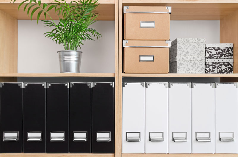 Shelf with organizers; keep your work or life organized with our maid services - purging & organizing